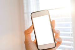 Smartphone in der Hand Lizenzfreies Stockbild