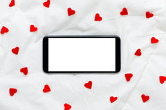 Smartphone des leeren Bildschirms auf einem weißen weichen silk Hintergrund Lizenzfreie Stockbilder