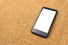 Smartphone on desktop Stock Image