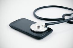 Smartphone diagnose by stethoscope. Royalty Free Stock Images