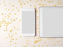 Smartphone, Digital tablet, Alphabet noodles, Cooking app Stock Photos