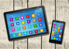 Smartphone and digital tablet PC with desktop icons on a white w Royalty Free Stock Photos
