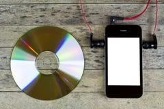 Smartphone, disco cd, auricular Imagen de archivo