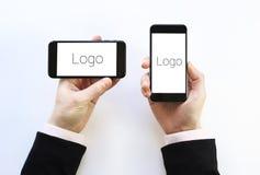Smartphone a disposición Foto de archivo libre de regalías