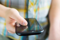 Smartphone a disposizione Fotografia Stock Libera da Diritti