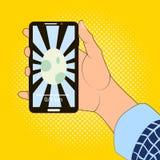 Smartphone a disposizione con l'immagine del gioco dell'uovo Immagini Stock Libere da Diritti