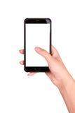 Smartphone a disposizione su un fondo bianco Facendo uso dello smartphone Fotografia Stock