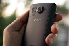 Smartphone do desejo HD da preensão HTC da mão Fotografia de Stock