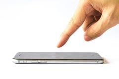 Smartphone do toque do dedo da mão no fundo branco Fotografia de Stock Royalty Free