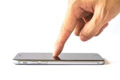Smartphone do toque do dedo da mão no fundo branco Fotografia de Stock