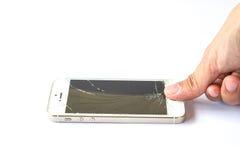 Smartphone do toque do dedo da mão quebrado no fundo branco Imagem de Stock