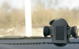 Smartphone dock in a car Royalty Free Stock Photography