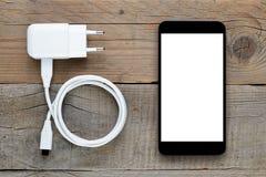 Smartphone e carregador fotografia de stock royalty free