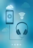 Smartphone e fones de ouvido Fotografia de Stock Royalty Free