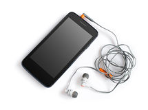 Smartphone e fones de ouvido pretos Fotografia de Stock