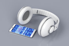 Smartphone e fones de ouvido sem fio Imagens de Stock Royalty Free