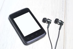 Smartphone and earphone Royalty Free Stock Photo