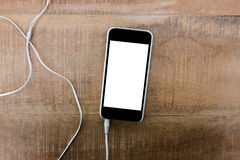 Smartphone with earphone Royalty Free Stock Image