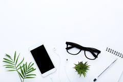 Smartphone with earphones and plants royalty free stock images