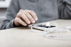 Smartphone with earphones Stock Photos