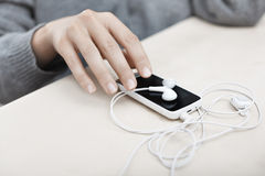 Smartphone with earphones Stock Photography