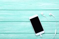 Smartphone with earphones royalty free stock photos