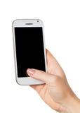 Smartphone in einer weiblichen Hand stockbild