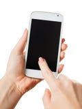 Smartphone in einer weiblichen Hand lizenzfreie stockbilder