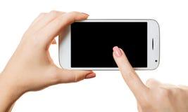 Smartphone in einer weiblichen Hand lizenzfreies stockbild