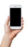 Smartphone in einer weiblichen Hand Lizenzfreies Stockfoto