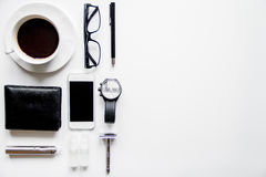 Smartphone, electronic cigarette and men`s accessories top view Stock Photography