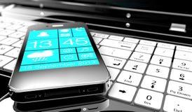 Smartphone em um portátil Imagem de Stock Royalty Free