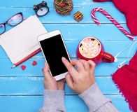 Smartphone with an empty black screen in female hands royalty free stock photos