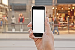 Smartphone with empty screen in woman hand in shopping center Stock Images