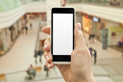 Smartphone with empty screen in woman hand in shopping center Stock Image