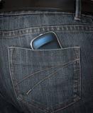 Smartphone en bolsillo de pantalones Fotografía de archivo libre de regalías