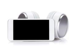 Smartphone en hoofdtelefoons royalty-vrije stock fotografie