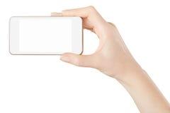 Smartphone en la mano femenina que toma la imagen imagen de archivo