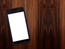 Smartphone en la tabla de madera, espacio de la copia para el anuncio imagenes de archivo