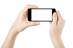 Smartphone en las manos femeninas que toman la foto imagen de archivo