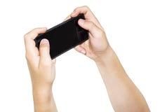 Smartphone en manos Imágenes de archivo libres de regalías