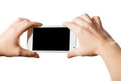 Smartphone en manos femeninas imagenes de archivo