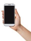 Smartphone en una mano femenina fotografía de archivo