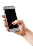 Smartphone en una mano femenina imagen de archivo libre de regalías