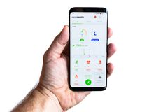 Smartphone with Endomondo app in hand. GDANSK, POLAND - NOVEMBER 23, 2017: Brand new black Samsung Galaxy S8 in hand isolated over white background. Endomondo Royalty Free Stock Photos