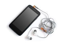 Smartphone et écouteurs noirs Photographie stock