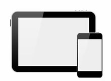 Smartphone et PC de tablette avec l'écran blanc Photographie stock
