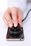 Smartphone examinou com um estetoscópio Foto de Stock Royalty Free