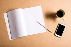 Smartphone and a exercise book Stock Photography