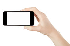 Smartphone in female hand taking photo stock photo
